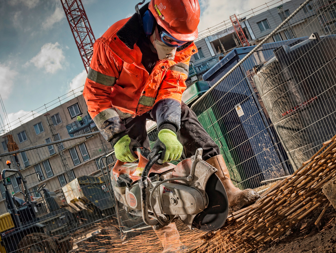 A construction worker using a power saw