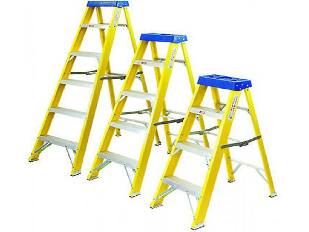 Three yellow and blue metal ladders of different sizes