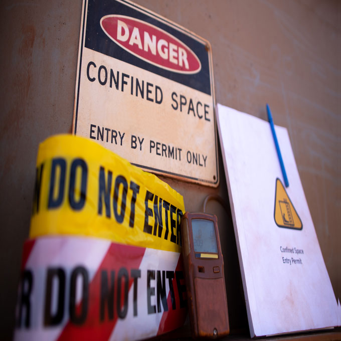 Confined spaces warning signs and 'do not' enter tape